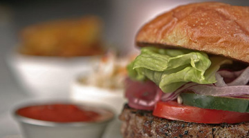 mouth watering burger with tomato and lettuce