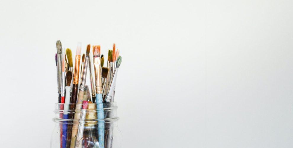 Mason jar full of paintbrushes
