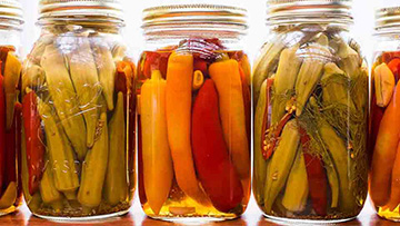 jars with picked okra and peppers